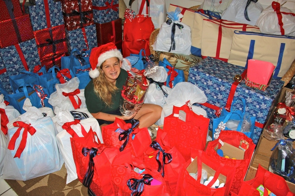 Photo of Hanna Button surrounded by gifts.